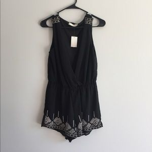 Other - Black romper with cream detailing