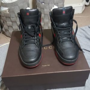 A pair of 9 1/2 usa Gucci high top black sneakers