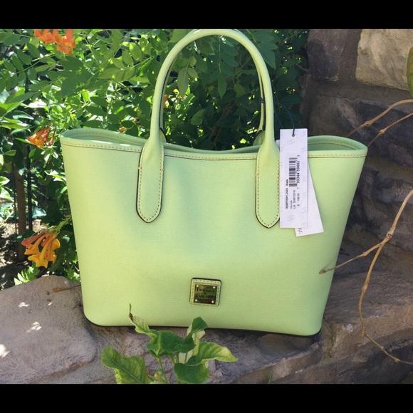 1203464a5a3da Dooney and Bourke key lime hand bag (Firm) NWT