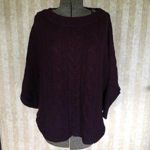 Eggplant colored cable knit sweater.
