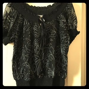 Black peasant top with white floral stitching