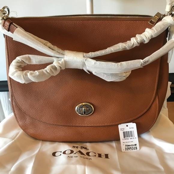 6322a95f8e3a Coach Handbags - COACH Turnlock Hobo in Saddle Tan Pebble Leather