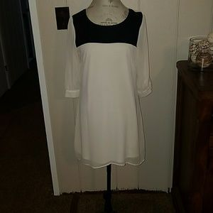 Dresses & Skirts - White dress with leather over part of chest area