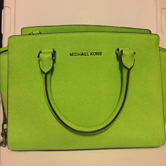 357293d9c59608 Michael kors lime green bag with silver hardware. M_59a6459c2ba50a2f52045b55