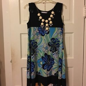 Go go style dress patterned with green, navy, aqua