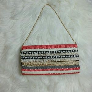 The Limited Woven Clutch