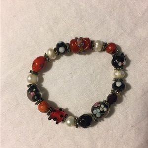 Jewelry - RED WHITE AND BLACK BEAD BRACELET