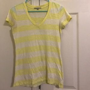 A Gap t-shirt that is yellow and white stripes.