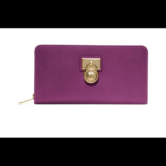 512f3c4bb1ce Michael Kors Purple Pomegranate Wallet. M 59e61a1841b4e08bec041a4c