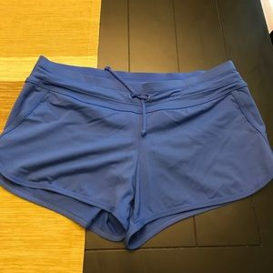Athleta blue swim shorts with liner