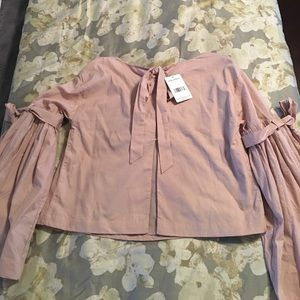 Free People Tops - New with tags ! Free people blouse ! Rose in color