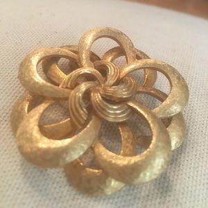 Large Corocraft signed gold swirl ribbon brooch.