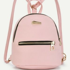 Handbags - NWT Mini Pink Backpack
