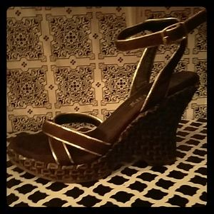 Brown with gold trim wedge sandles.