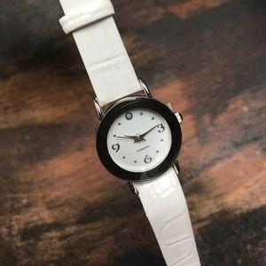 White Avon watch