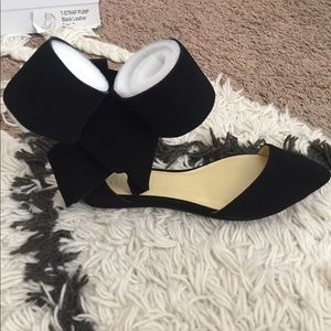 Black flats with a bow
