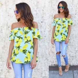 Sky Blue top with yellow floral pattern NWOT
