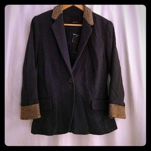 Blazer with chains on collar and sleeves.