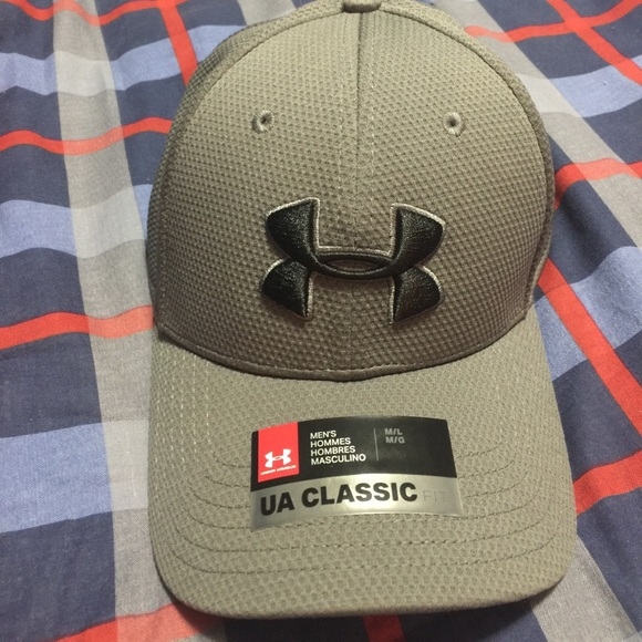 Under Armour Classic Fit Hat. NWT. Under Armour.  M 59addd0c291a35bfda003928. M 59addd222fd0b7576500302e.  M 59addd2dea3f36251e004294 d7217b9ee67