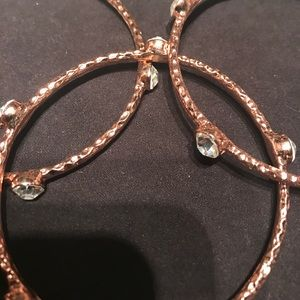 henri bendel Jewelry - SOLD‼️Rose gold and crystal bangles set of 3