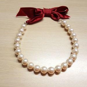 Necklace with crimson ribbon tie