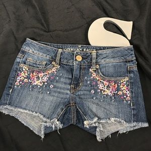 American Eagle cut off shorts with floral pockets