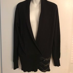NWOT. BEAUTIFUL BLACK CARDIGAN WITH STAPS.
