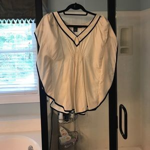 Top with winged sleeves