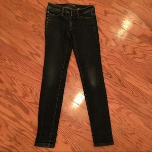 Bebe faded stressed jeans size 25