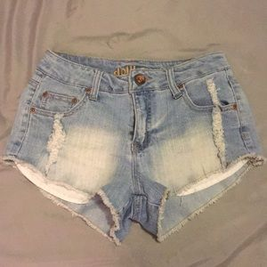 Washed up ripped denim shorts