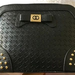 Handbags - Black leather cross body bag with gold studs