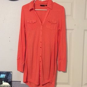 Orange long sleeve dress.