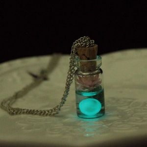 Jewelry - Luminous glass bottle charm necklace.