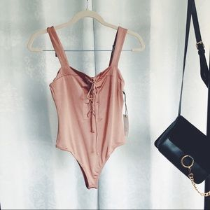 Tops - 🆕Clara Pink Blush Lace Up Bodysuit