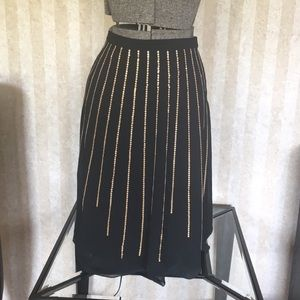 Black skirt with gold sequined stripes