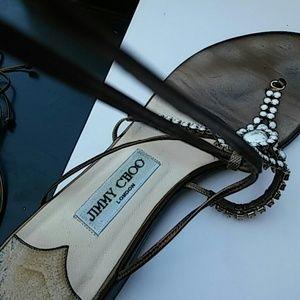 JIMMY CHOO beaded gladiators sandals.