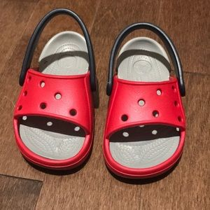 Brand new crocks, size 6/7 in red. No tags