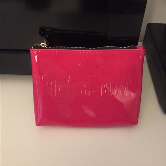 YSL pink patent makeup case. M 59b5477a2599fecc6403eba4 fec7111d7d2c8