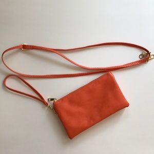 Handbags - Orange faux leather wristlet/cross body bag