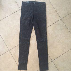Coated black w/ cheetah printed design skinny jean