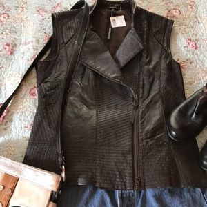 Tops - NEW LISTING. Leather motorcycle vest