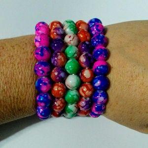 Neon swirl beaded bracelets $6 each