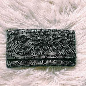 Mesh metal-metallic snakeskin clutch