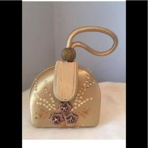 Handbags - NWT gold wristlets with beaded details