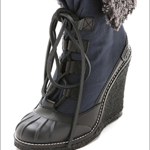 4422b32f3a5 Tory Burch Fairfax shearling lined wedge boots. M 59b76c49291a3568560c51ef