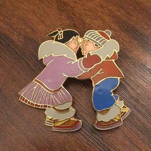 Cloisonné Eskimo or bundled couple pin children