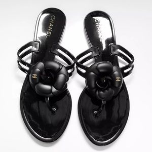 Chanel jelly Camellia Thong sandals.