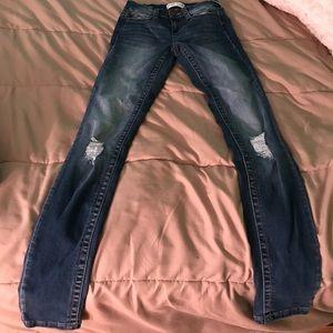 mud distressed skinny jeans