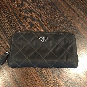 Prada zip around quilted wallet