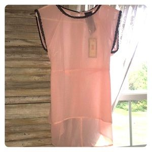 NWT pink sleeveless top with beaded detail.